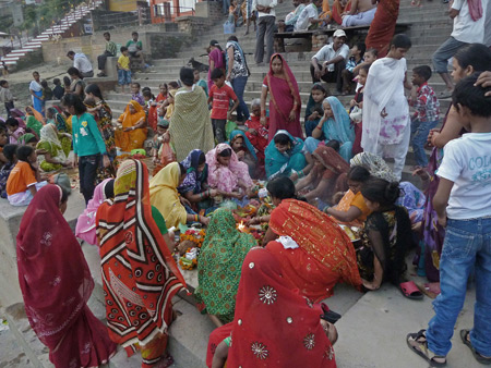 A group of women performs a Hindu ceremony at Kedar Ghat in Varanasi, India.