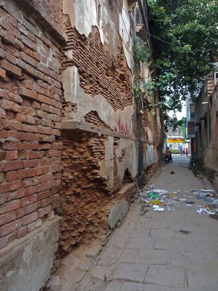 A blown-out wall in a back lane in Varanasi, India.