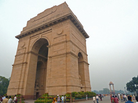 Throngs of people stroll around India Gate in Central Delhi, India.