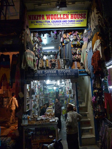 Overflowing shops are all stacked up in Main Bazaar, Paharganj, Delhi, India.