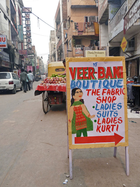 A colorful sign beckons passersby into a shop in the back lanes of Paharganj, Delhi, India.