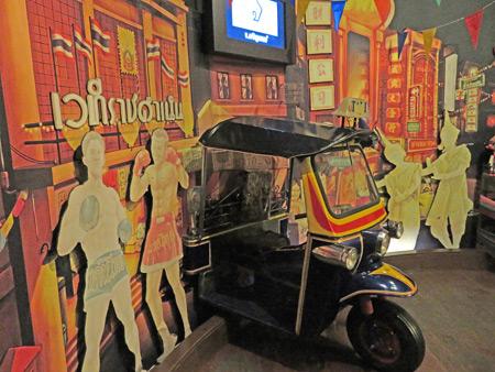 Ride a tuk-tuk at the Museum of Siam in Rattanakosin, Bangkok, Thailand.