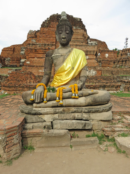 A Buddha image at Wat Maha That in Ayutthaya, Thailand.