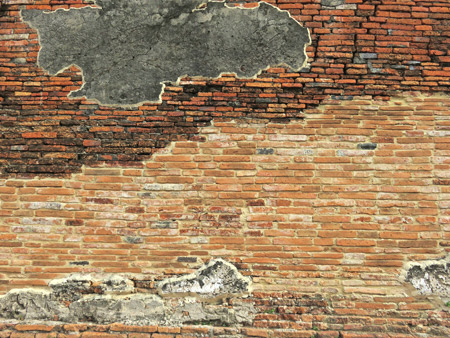 A distressed wall at Wat Maha That in Ayutthaya, Thailand.