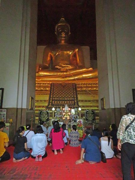 An evening prayer service at Wihan Phra Mongkhon Bhopit in Ayutthaya, Thailand.