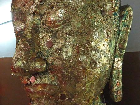 A close-up of a Buddha image at Wihan Phra Mongkhon Bhopit in Ayutthaya, Thailand.