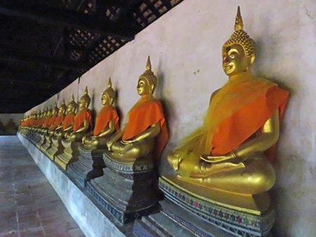 A long row of Buddha images at Wat Phutthai Sawan in Ayutthaya, Thailand.