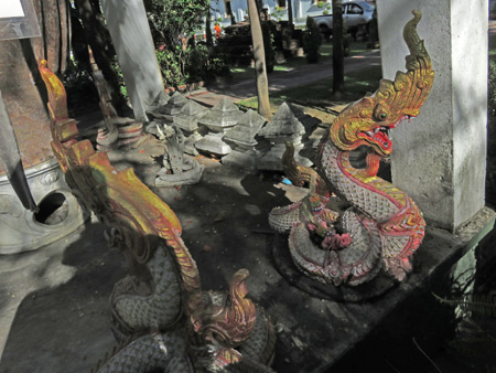 A couple of old, small dragons at Wat Phra Singh in Chiang Mai, Thailand.