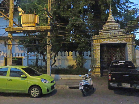 The power grid and a temple gate in Chiang Mai, Thailand.