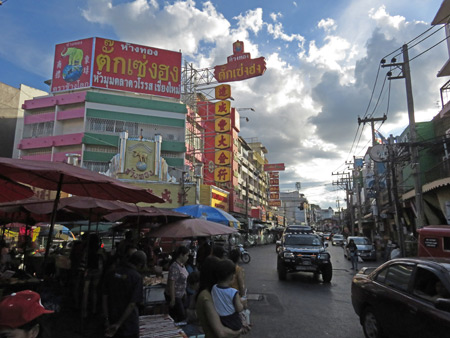 A bustling street scene in Chinatown, Chiang Mai, Thailand.