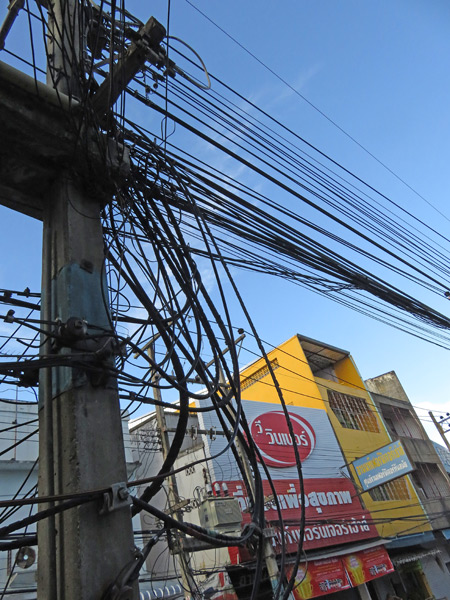 A mass of gnarled power lines in Chiang Mai, Thailand.