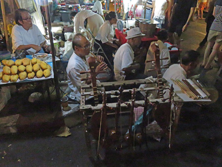 Traditional Thai musicians jam at a night market on Thanon Ratchadamnern in Chiang Mai, Thailand.