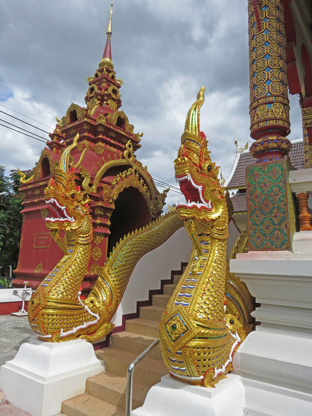 Golden dragons guard Wat That Kham in Chiang Mai, Thailand.