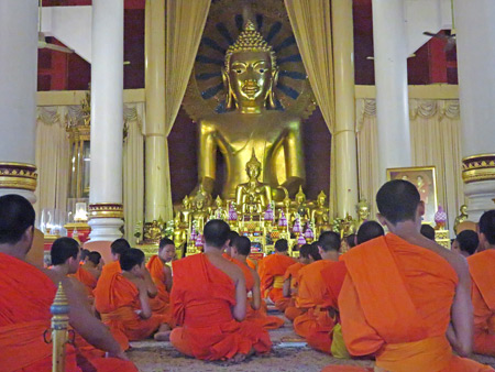 An afternoon Buddhist prayer service at Wat Phra Singh in Chiang Mai, Thailand.
