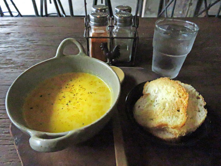 Carrot soup and toast at Veggie Cafe in Phitsanulok, Thailand.