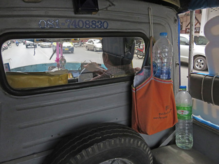 Taking a tuk-tuk to the bus station in Phitsanulok, Thailand.