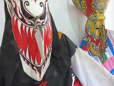 A couple of Phi Ta Khon masks at the Dan Sai Folk Museum in Dan Sai, Thailand.