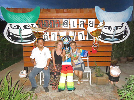 The Mountain Green Resort owner San and his wife Jam surround Mari from Norway in Dan Sai, Thailand.