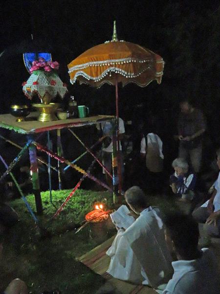 A Saen man conducts a ritual to summon Phra Uppakut at Wat Phon Chai in Dan Sai, Thailand.