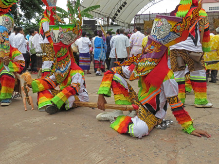 Some ghosts relax at the Phi Ta Khon festival at Wat Phon Chai in Dan Sai, Thailand.