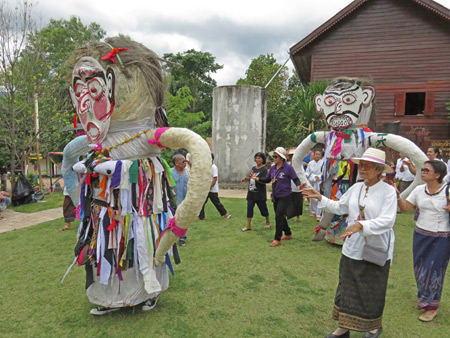 A procession of villagers walks three times around Wat Phon Chai during the Phi Ta Khon festival in Dan Sai, Thailand.