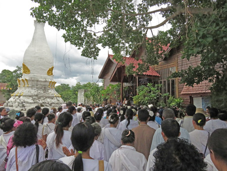 A procession of villagers walks three times around Wat Phon Chai during the Phi Ta Khon festival in Dan Sai, Thailand.