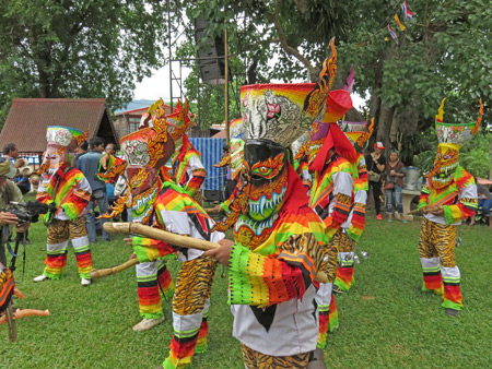 A group of ghosts dances during the Phi Ta Khon festival at Wat Phon Chai in Dan Sai, Thailand.