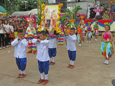 A parade of little people at the Phi Ta Khon festival at Wat Phon Chai in Dan Sai, Thailand.
