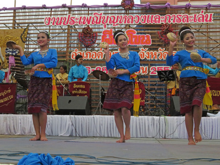 A women's troupe performs a traditional Thai dance at the Phi Ta Khon festival at Wat Phon Chai in Dan Sai, Thailand.