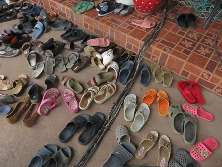 Take off your shoes at Chao Pho Kuan's house in Dan Sai, Thailand.
