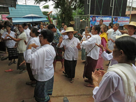 A dance party gets underway at the Bo Si or Summoning of the Spirits ceremony at Chao Pho Kuan's house in Dan Sai, Thailand.