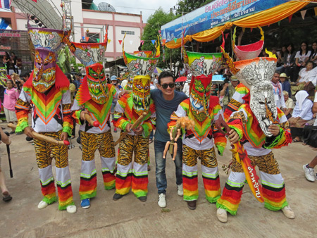 A group of ghosts pose for a photo during the Phi Ta Khon festival at Wat Phon Chai in Dan Sai, Thailand.