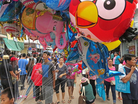Color-splashed chaos at the Phi Ta Khon festival in Dan Sai, Thailand.