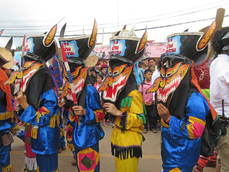 A group of ghosts poses in the parade at the Phi Ta Khon festival in Dan Sai, Thailand.