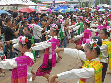 Young ladies dance in the parade at the Phi Ta Khon festival in Dan Sai, Thailand.