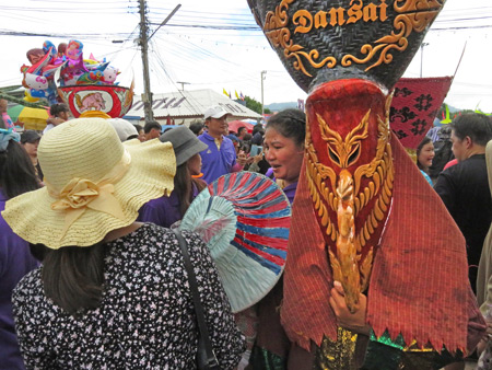 A lady and a ghost in the parade at the Phi Ta Khon festival in Dan Sai, Thailand.