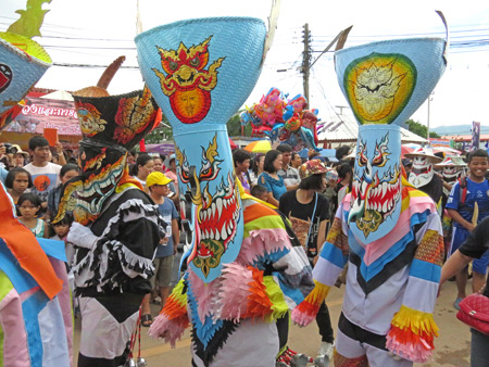 A group of ghosts walk in the parade at the Phi Ta Khon festival in Dan Sai, Thailand.