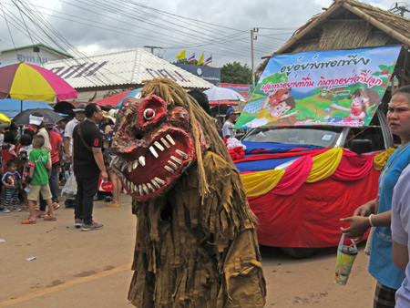 A demon stalks the parade at the Phi Ta Khon festival in Dan Sai, Thailand.
