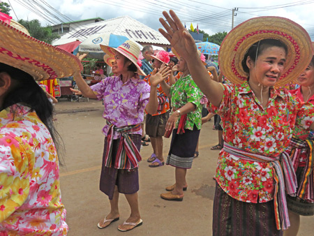 Older ladies dance in the parade at the Phi Ta Khon festival in Dan Sai, Thailand.