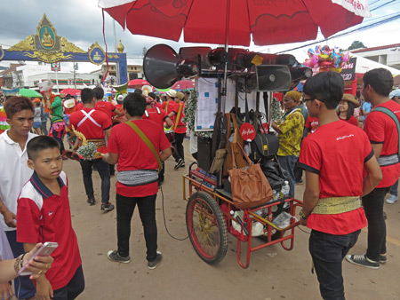 Air Asia blasts some tunes in the parade at the Phi Ta Khon festival in Dan Sai, Thailand.