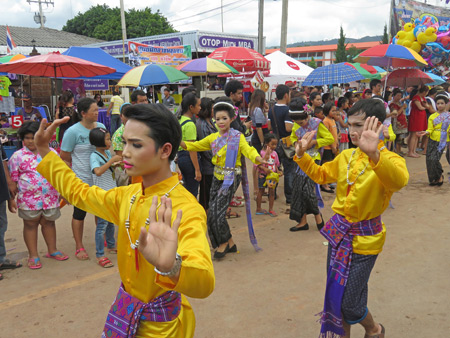 Lady boys dance in the parade at the Phi Ta Khon festival in Dan Sai, Thailand.