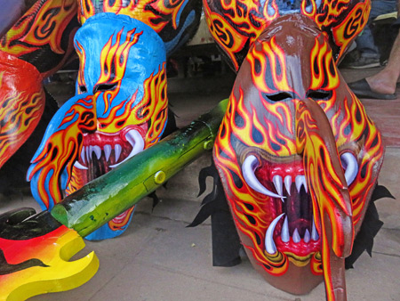 Some flame-filled ghost masks in front of a shop after the parade at the Phi Ta Khon festival in Dan Sai, Thailand.