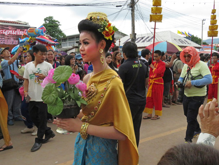 An elegant lady walks in the parade at the Phi Ta Khon festival in Dan Sai, Thailand.