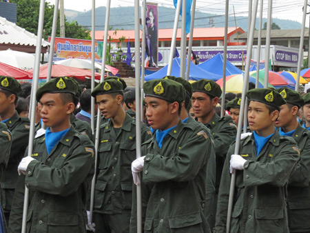 Some military boys join the parade at the Phi Ta Khon festival in Dan Sai, Thailand.