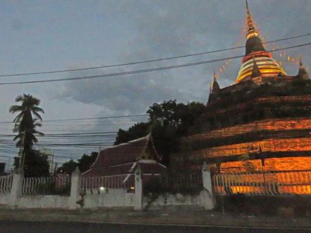 Wat Ratcha Burana glows at dusk in Phitsanulok, Thailand.