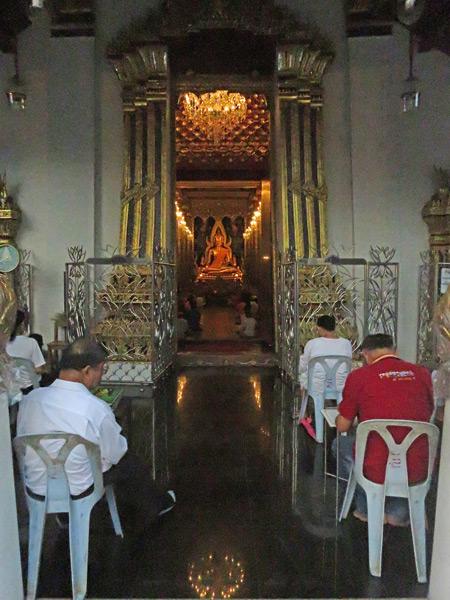 An evening prayer service at Wat Phra Sri Rattana Mahathat in Phitsanulok, Thailand.
