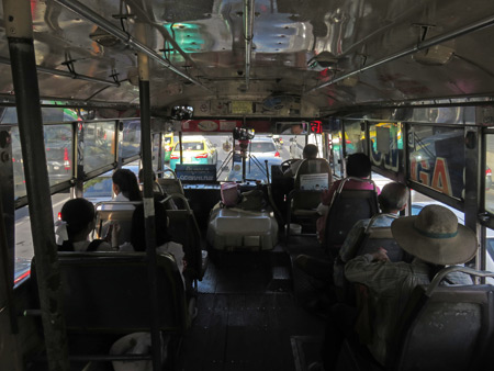 A pleasant afternoon on bus number 15 in Bangkok, Thailand.