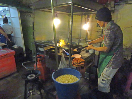 Legendary wok star Mr. Dum goes off on Sukhumvit Soi 38 in Sukhumvit, Bangkok, Thailand.