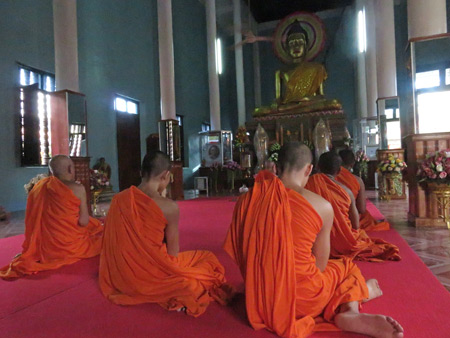 An evening Buddhist prayer service at Wat Preah Prom Rath in Siem Reap, Cambodia.