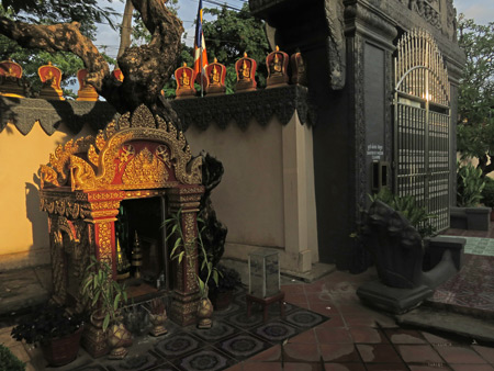 A small Buddhist shrine in the setting sun at Wat Preah Prom Rath in Siem Reap, Cambodia.